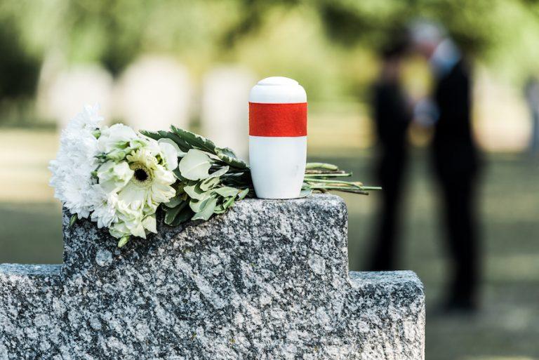 An Urn Sitting On A Gravestone