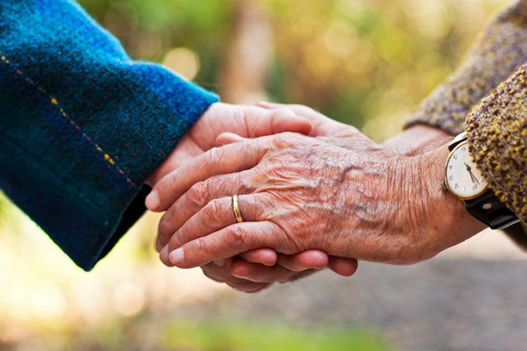 Elderly Couple Holding Hands