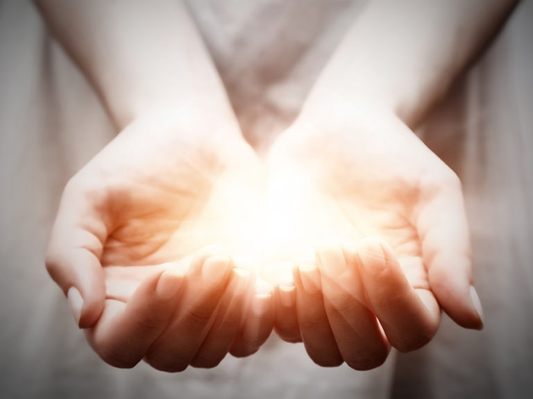 Cupped Hands Holding a Light