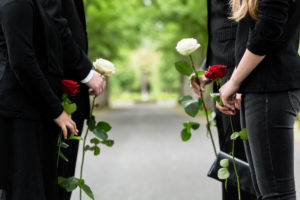 Family in guard of honor at funeral