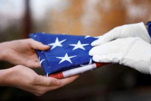 Handing Over Folded American Flag